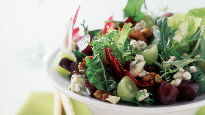 baby-greens-with-grapes-hot-sweet-pecans-and-gorgonzola
