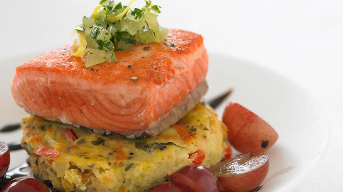 salmon on polenta with sliced grapes