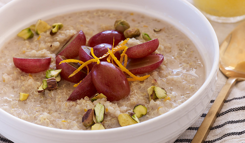 quinoa breakfast cereal with grapes and pistachios